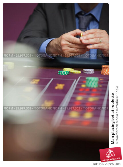 Купить «Man placing bet at roulette», фото № 29997303, снято 20 июля 2012 г. (c) Wavebreak Media / Фотобанк Лори