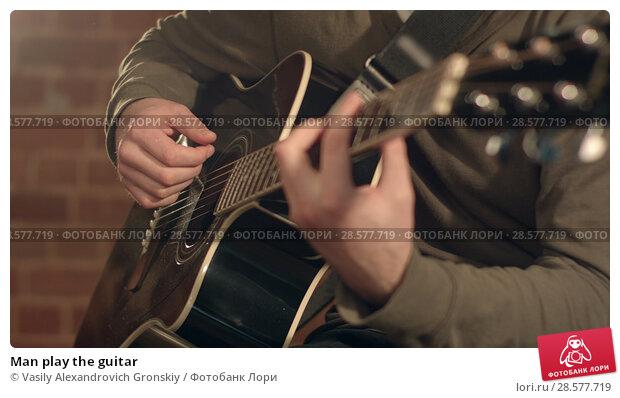 Купить «Man play the guitar», фото № 28577719, снято 25 июня 2018 г. (c) Vasily Alexandrovich Gronskiy / Фотобанк Лори