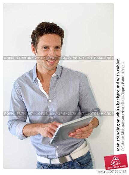 Купить «Man standing on white background with tablet», фото № 27791167, снято 24 октября 2018 г. (c) PantherMedia / Фотобанк Лори