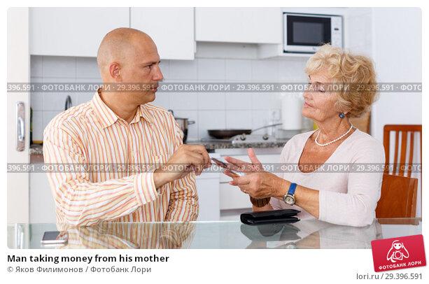 Купить «Man taking money from his mother», фото № 29396591, снято 11 июля 2018 г. (c) Яков Филимонов / Фотобанк Лори