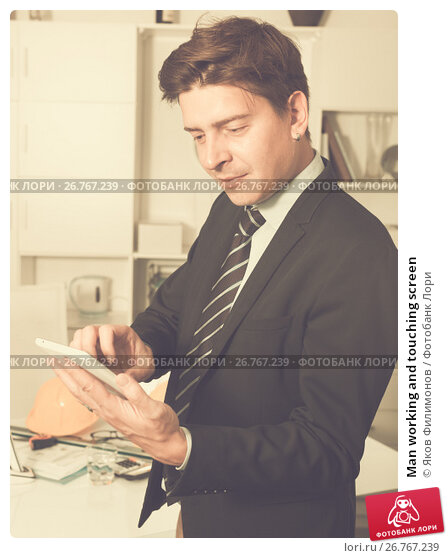 Купить «Man working and touching screen», фото № 26767239, снято 25 апреля 2017 г. (c) Яков Филимонов / Фотобанк Лори