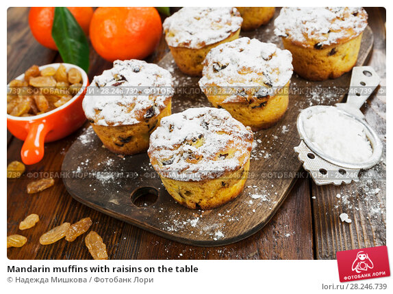 Купить «Mandarin muffins with raisins on the table», фото № 28246739, снято 6 января 2018 г. (c) Надежда Мишкова / Фотобанк Лори