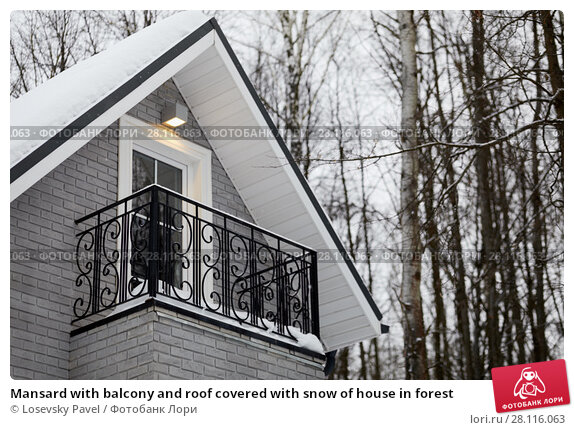 Купить «Mansard with balcony and roof covered with snow of house in forest», фото № 28116063, снято 5 февраля 2017 г. (c) Losevsky Pavel / Фотобанк Лори