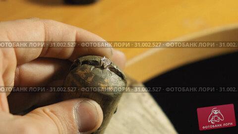 Купить «Manual fixing the crown with the gemstone using tweezers sloiw motion», видеоролик № 31002527, снято 4 августа 2020 г. (c) Denis Mishchenko / Фотобанк Лори