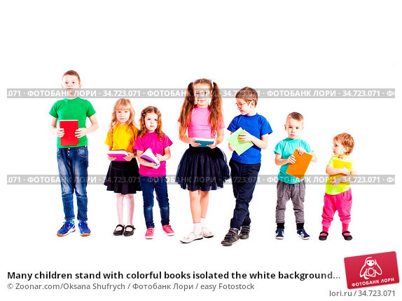 Many children stand with colorful books isolated the white background... Стоковое фото, фотограф Zoonar.com/Oksana Shufrych / easy Fotostock / Фотобанк Лори