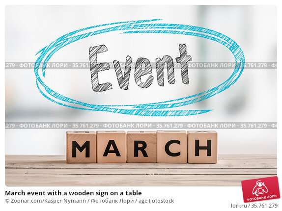 March event with a wooden sign on a table. Стоковое фото, фотограф Zoonar.com/Kasper Nymann / age Fotostock / Фотобанк Лори