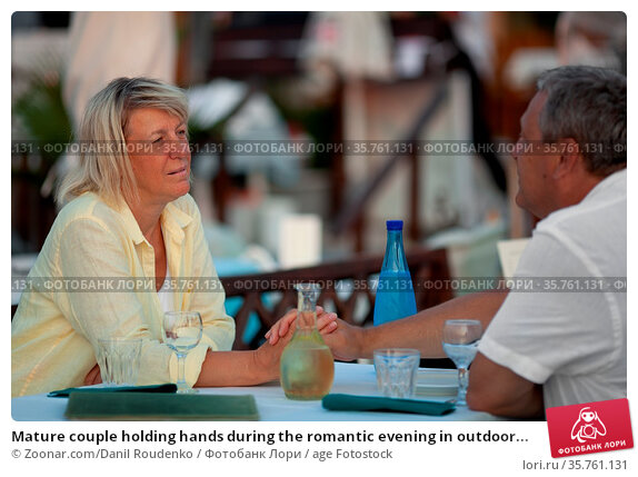 Mature couple holding hands during the romantic evening in outdoor... Стоковое фото, фотограф Zoonar.com/Danil Roudenko / age Fotostock / Фотобанк Лори