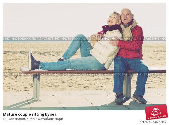 Купить «Mature couple sitting by sea», фото № 27075447, снято 11 декабря 2017 г. (c) Яков Филимонов / Фотобанк Лори