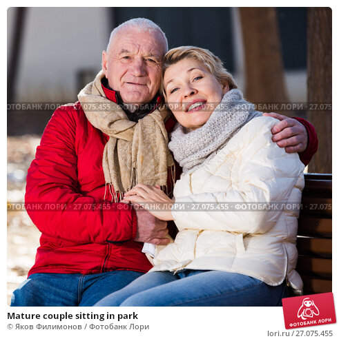 Купить «Mature couple sitting in park», фото № 27075455, снято 16 января 2018 г. (c) Яков Филимонов / Фотобанк Лори