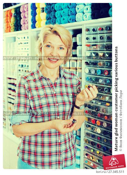 Купить «Mature glad woman customer picking various buttons», фото № 27345511, снято 20 мая 2019 г. (c) Яков Филимонов / Фотобанк Лори