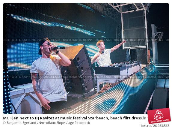 Купить «MC Tjen next to DJ Ravitez at music festival Starbeach, beach flirt dress in white party, on 17. July 2017 in Hersonissos, Crete, Greece, Europe», фото № 26933563, снято 17 июля 2017 г. (c) age Fotostock / Фотобанк Лори