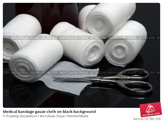 Купить «Medical bandage gauze cloth on black background», фото № 27781315, снято 17 февраля 2019 г. (c) PantherMedia / Фотобанк Лори