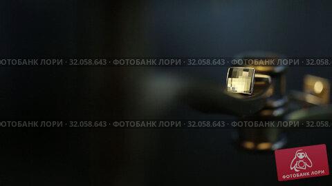 Men's golden cufflinks for a shirton Macro slider closeup. Стоковое видео, видеограф Aleksejs Bergmanis / Фотобанк Лори