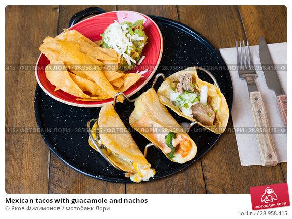 Купить «Mexican tacos with guacamole and nachos», фото № 28958415, снято 24 апреля 2019 г. (c) Яков Филимонов / Фотобанк Лори