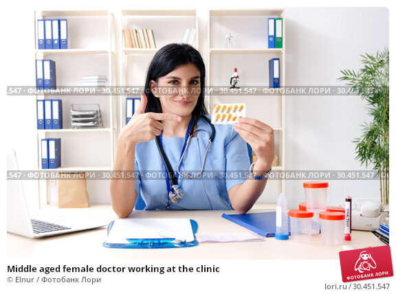 Middle aged female doctor working at the clinic. Стоковое фото, фотограф Elnur / Фотобанк Лори