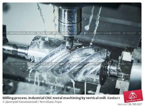 Milling process. Industrial CNC metal machining by vertical mill. Coolant. Стоковое фото, фотограф Дмитрий Калиновский / Фотобанк Лори