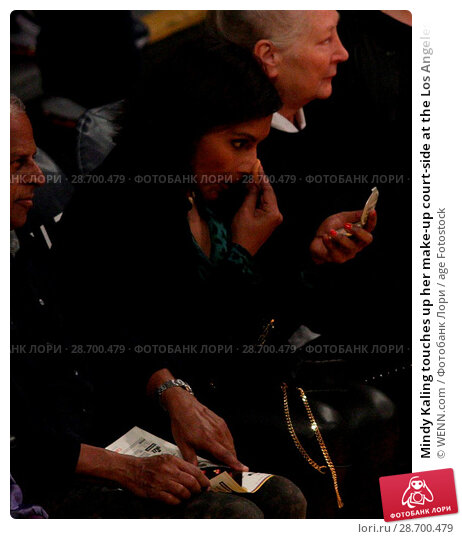 Купить «Mindy Kaling touches up her make-up court-side at the Los Angeles Lakers vs The Utah Jazz game at the Staples Center Featuring: Mindy Kaling Where: Los...», фото № 28700479, снято 28 декабря 2016 г. (c) age Fotostock / Фотобанк Лори