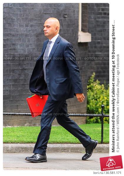 Купить «Ministers attend the weekly Cabinet meeting at 10 Downing Street ahead of tomorrow's Queens Speech Featuring: Sajid JavidMP Where: London, United Kingdom...», фото № 30581171, снято 20 июня 2017 г. (c) age Fotostock / Фотобанк Лори