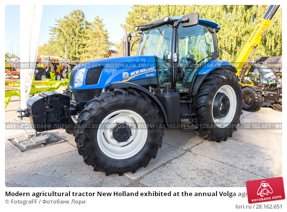 Купить «Modern agricultural tractor New Holland exhibited at the annual Volga agro-industrial exhibition», фото № 28162651, снято 23 сентября 2017 г. (c) FotograFF / Фотобанк Лори