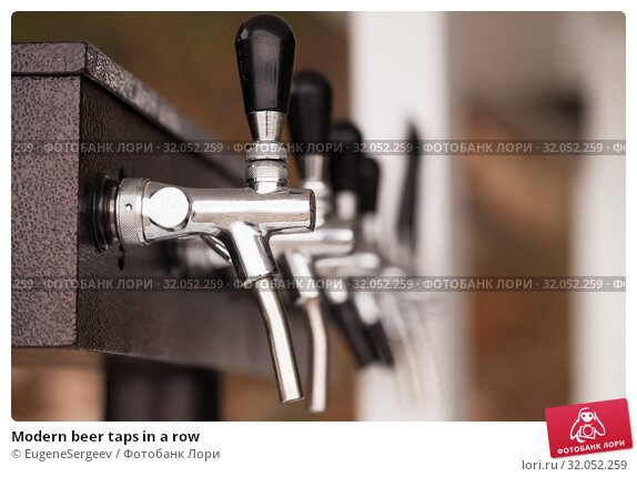 Modern beer taps in a row. Стоковое фото, фотограф EugeneSergeev / Фотобанк Лори