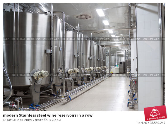 Купить «modern Stainless steel wine reservoirs in a row», фото № 28539247, снято 21 июня 2018 г. (c) Татьяна Яцевич / Фотобанк Лори