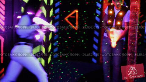 Купить «Modern young people with laser pistols playing laser tag on dark labyrinth», видеоролик № 29032015, снято 22 мая 2018 г. (c) Яков Филимонов / Фотобанк Лори