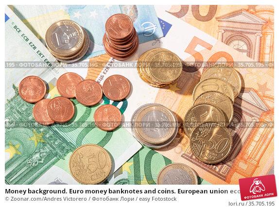 Money background. Euro money banknotes and coins. European union economy... Стоковое фото, фотограф Zoonar.com/Andres Victorero / easy Fotostock / Фотобанк Лори