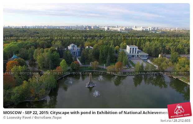 Купить «MOSCOW - SEP 22, 2015: Cityscape with pond in Exhibition of National Achievements at autumn sunny day. Aerial view videoframe», фото № 28212603, снято 22 сентября 2015 г. (c) Losevsky Pavel / Фотобанк Лори