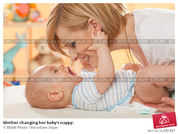 Купить «Mother changing her baby's nappy.», фото № 6292851, снято 17 июня 2019 г. (c) BE&W Photo / Фотобанк Лори