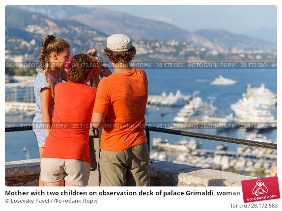 Купить «Mother with two children on observation deck of palace Grimaldi, woman looks through binoculars», фото № 28172583, снято 3 августа 2016 г. (c) Losevsky Pavel / Фотобанк Лори