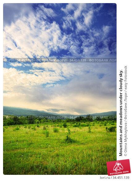 Mountains and meadows under cloudy sky. Стоковое фото, фотограф Olena Mykhaylova / easy Fotostock / Фотобанк Лори