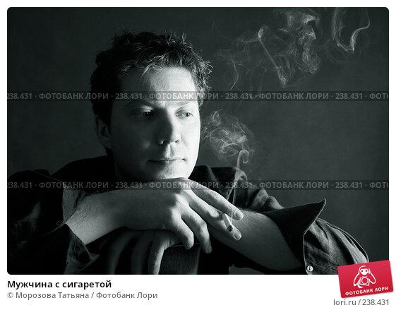 Мужчина с сигаретой, фото № 238431, снято 24 декабря 2006 г. (c) Морозова Татьяна / Фотобанк Лори