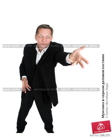 Купить «Мужчина в черном деловом костюме», фото № 208275, снято 18 октября 2007 г. (c) hunta / Фотобанк Лори
