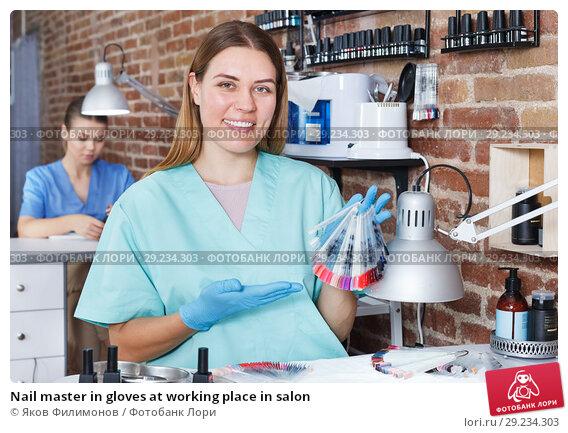 Купить «Nail master in gloves at working place in salon», фото № 29234303, снято 30 мая 2018 г. (c) Яков Филимонов / Фотобанк Лори
