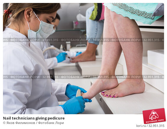 Nail technicians giving pedicure. Стоковое фото, фотограф Яков Филимонов / Фотобанк Лори