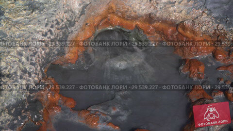 Купить «Natural volcanic hot springs splashing of boiling water from hole», видеоролик № 29539227, снято 26 сентября 2018 г. (c) А. А. Пирагис / Фотобанк Лори