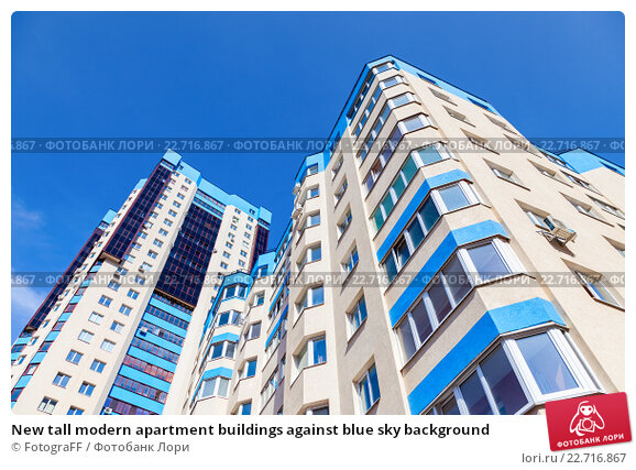 New tall modern apartment buildings against blue sky background, фото № 22716867, снято 25 июня 2017 г. (c) FotograFF / Фотобанк Лори