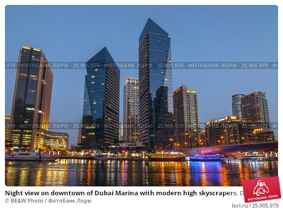 Купить «Night view on downtown of Dubai Marina with modern high skyscrapers. Dubai downtown, United Arab Emirates», фото № 25905979, снято 4 сентября 2018 г. (c) BE&W Photo / Фотобанк Лори