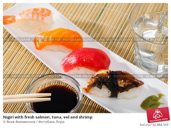 Купить «Nigiri with fresh salmon, tuna, eel and shrimp», фото № 32984103, снято 31 марта 2020 г. (c) Яков Филимонов / Фотобанк Лори