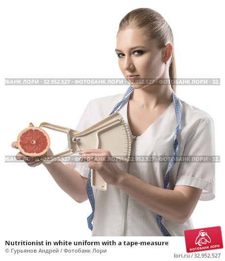 Nutritionist in white uniform with a tape-measure. Стоковое фото, фотограф Гурьянов Андрей / Фотобанк Лори