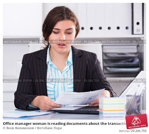 Купить «Office manager woman is reading documents about the transaction», фото № 29206759, снято 21 мая 2017 г. (c) Яков Филимонов / Фотобанк Лори