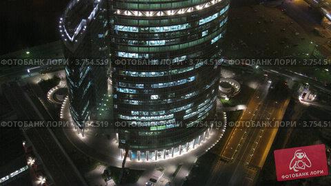 """Купить «Офисный комплекс """"Башня на набережной"""", таймлапс ночью», видеоролик № 3754519, снято 26 сентября 2011 г. (c) Losevsky Pavel / Фотобанк Лори"""