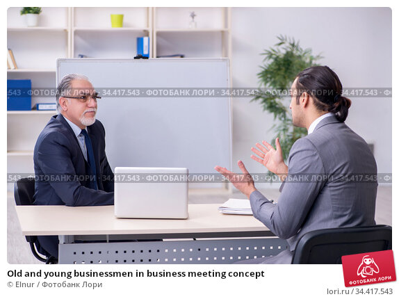 Old and young businessmen in business meeting concept. Стоковое фото, фотограф Elnur / Фотобанк Лори