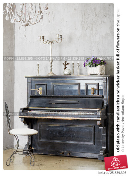 Old piano with candlesticks and wicker basket full of flowers on the upper lid in room, фото № 25839395, снято 29 марта 2015 г. (c) Losevsky Pavel / Фотобанк Лори