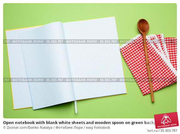 Open notebook with blank white sheets and wooden spoon on green background... Стоковое фото, фотограф Zoonar.com/Danko Natalya / easy Fotostock / Фотобанк Лори
