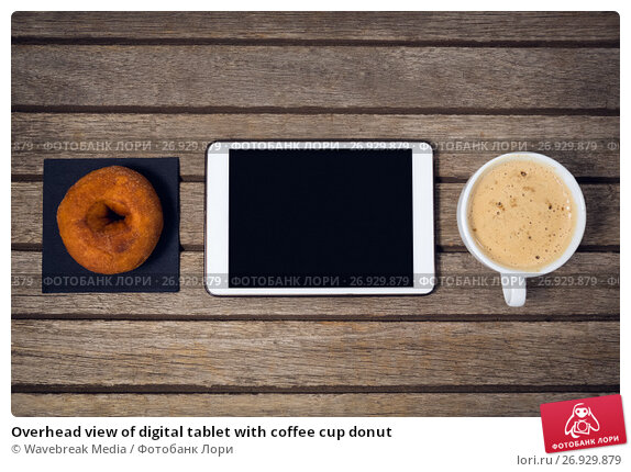 Overhead view of digital tablet with coffee cup donut, фото № 26929879, снято 26 мая 2017 г. (c) Wavebreak Media / Фотобанк Лори