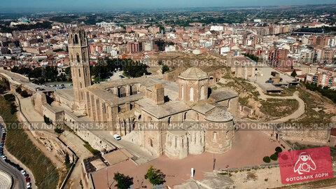 Купить «Panoramic view from drone of Catalan city of Lleida with medieval Cathedral of St. Mary of La Seu Vella», видеоролик № 30943595, снято 25 июля 2018 г. (c) Яков Филимонов / Фотобанк Лори