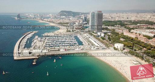 Купить «Panoramic view of historical districts of Barcelona with Mediterranean in sunny day», видеоролик № 29309991, снято 27 июня 2018 г. (c) Яков Филимонов / Фотобанк Лори