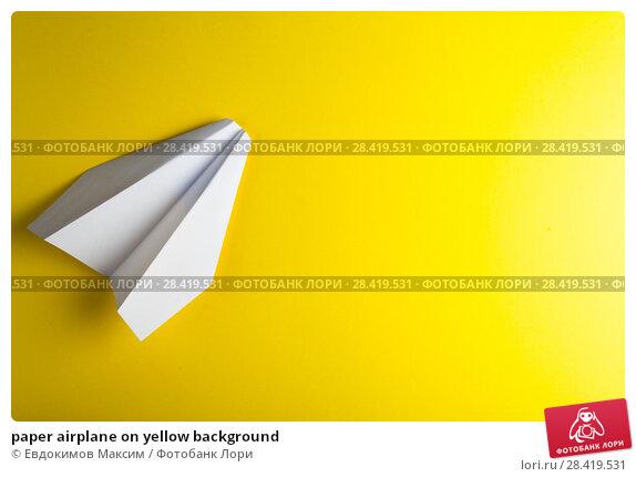 Купить «paper airplane on yellow background», фото № 28419531, снято 24 апреля 2018 г. (c) Евдокимов Максим / Фотобанк Лори