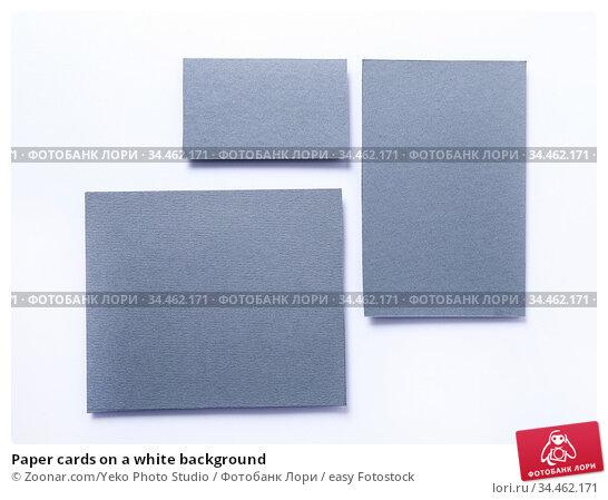 Paper cards on a white background. Стоковое фото, фотограф Zoonar.com/Yeko Photo Studio / easy Fotostock / Фотобанк Лори